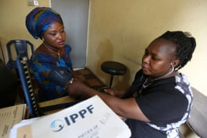 Hassan Roseline, who has been working as PPFN clinic officer for two years, checks the blood presure of Toyin Oladipo at a PPFN clinic in Lagos