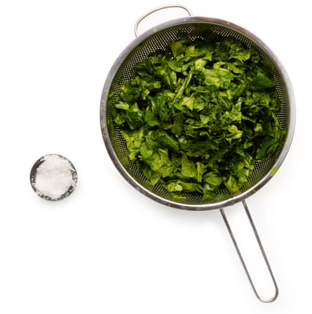 Trim, wash and chop the spinach. Photographs by Dan Matthews for the Guardian.