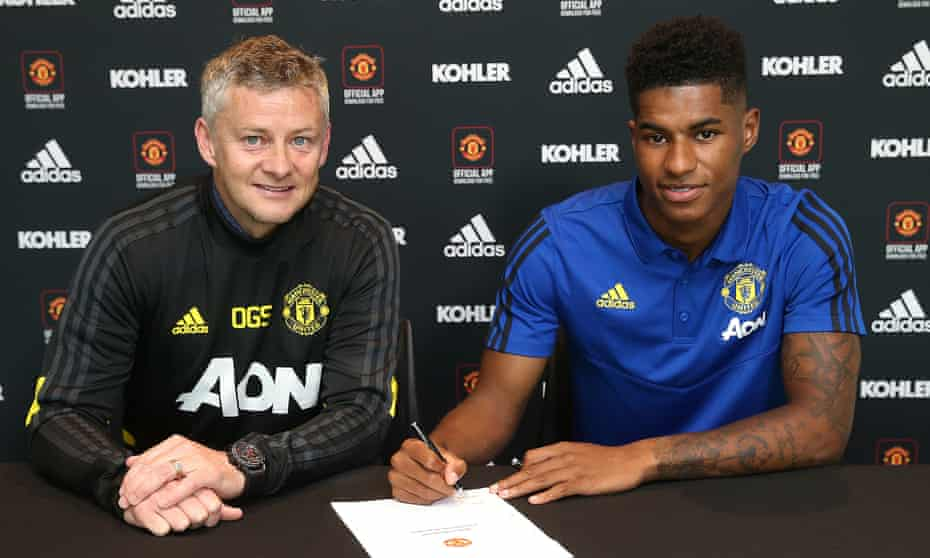 Marcus Rashford of Manchester United poses with Manager Ole Gunnar Solskjær after signing a contract extension with the club.