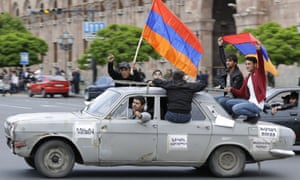 Protesters hold Armenian national flags as they gather at Republic Square in Yerevan.