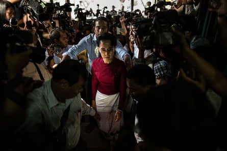 Aung San Suu Kyi arrives at a polling station during Myanmar's first free and fair election on 8 November 2015