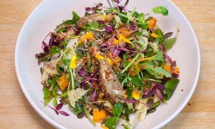 A salad of lentils, fennel and Jerusalem artichokes in a large shallow white bowl