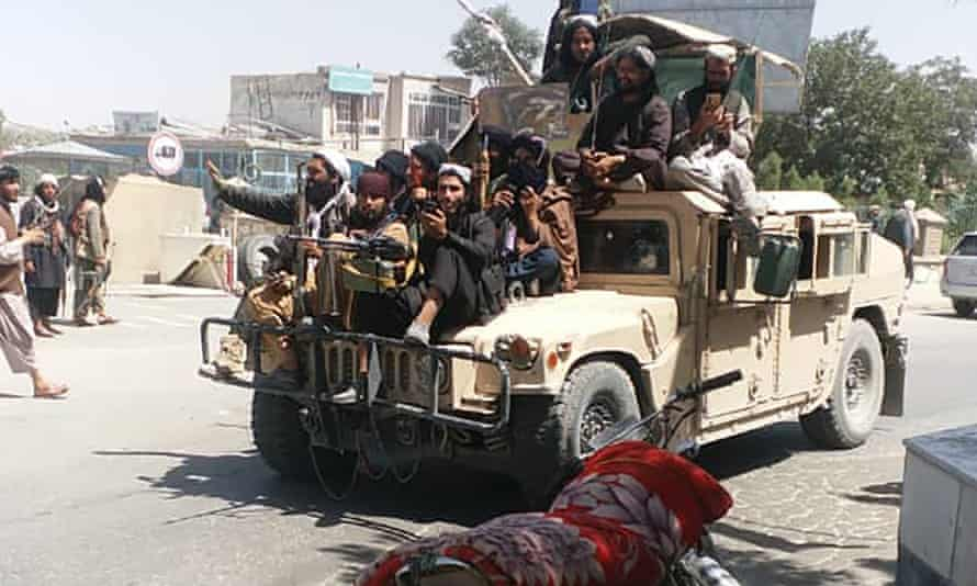 Taliban fighters seen patrolling the city of Ghazni