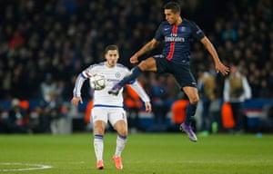 Eden Hazard watches as Marquinhos flicks on.