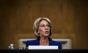 Betsy DeVos faces questions from the Senate committee on health, education, labor and pensions during her confirmation hearing on 17 January.