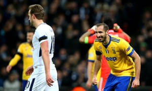 Giorgio Chiellini of Juventus smiles towards Tottenham's Harry Kane after putting one over his old adversary.