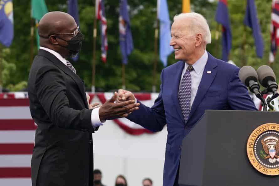 Joe Biden greets Senator Raphael Warnock at a rally in Duluth, Georgia.