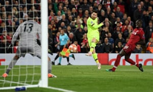 Lionel Messi has his shot saved by Alisson during Liverpool's 4-0 win over Barcelona.