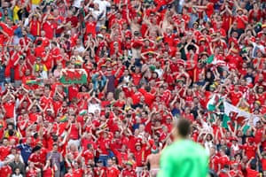 Wales fans celebrate at the final whistle in Bordeaux