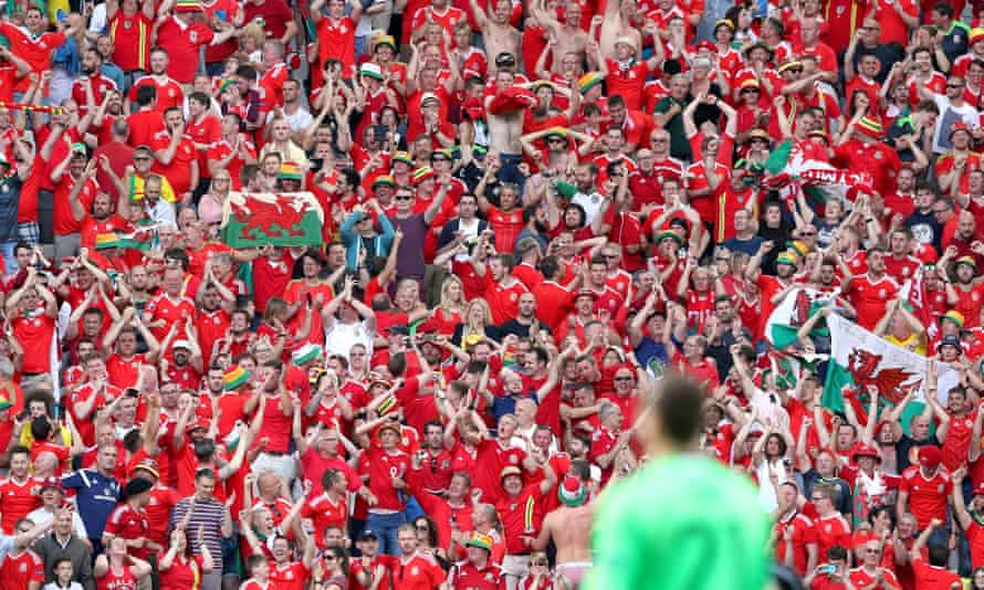 Wales fans in the stands celebrate the 2-1 victory against Slovakia at the Stade de Bordeaux