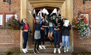 Students at King Edward VI high school for girls in Birmingham jump for joy after receiving their exam results