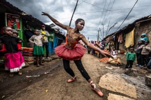 Elsie Ayoo, 16, a young dancer, practices on a street corner in Kibera. Ballet is being taught at schools in Kibera through an arts programme run by charities Anno's Africa and One Fine Day.