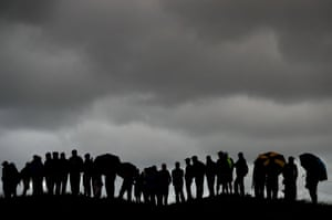 Southport, UK Fans gather on a miserable day to watch the action during day one of The Open Championship at Royal Birkdale Golf Club