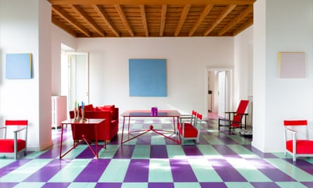Square visions: Dalila Formentini and Sean Shanahan's dining room, with block colour paintings and coated iron tables.