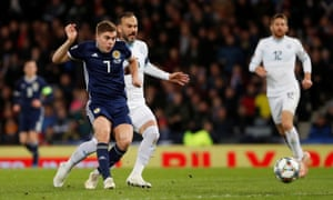 James Forrest slots the ball home for his hat-trick.
