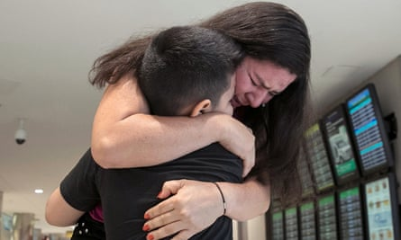 Andy, seven, originally from El Salvador and detained in Texas, is reunited with his mother Arley, at Baltimore-Washington international airport on 23 July.