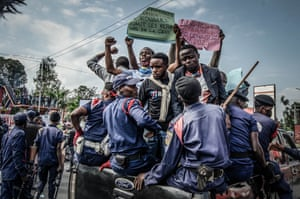 Protesters are arrested by police in the eastern city of Goma on 13 July while denouncing the nomination of an election commission chief accused of rigging past elections in favour of former president Joseph Kabila.