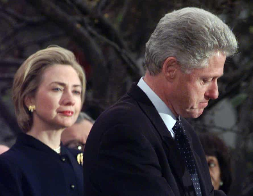 Hillary Clinton watches on as her husband thanks the Democratic House members who voted against impeachment in December 1998