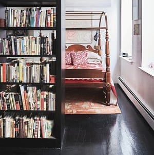 The bedroom behind the bookshelf.