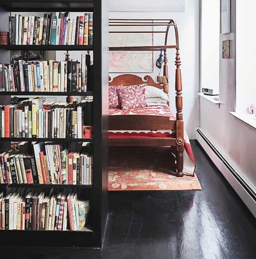 The bedroom behind the bookshelf.
