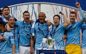 Kompany and his City teammates add the League Cup to the trophy room after winning 3-1.