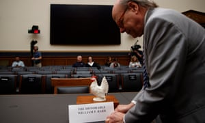 Congressman Steve Cohen places a ceramic chicken at the empty witness seat for the attorney general, William Barr at a House Judiciary Committee meeting.