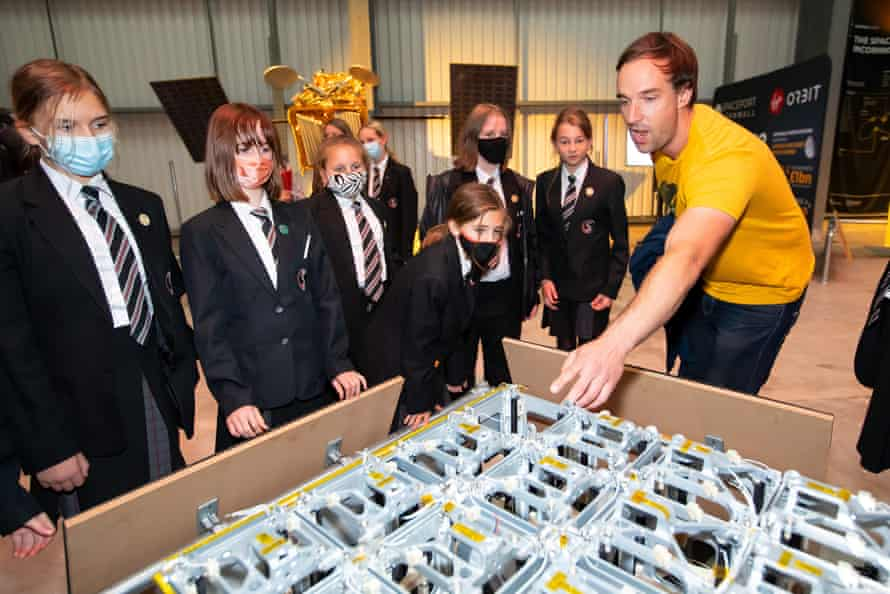 Dave Pollard, Spaceport Cornwall's outreach manager, talks to a group of school children about a device that can dispatch individual satellites into differing orbits.