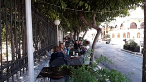 Greeks enjoy a moment of normality in a cafe in central Athens.