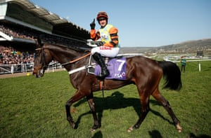 Nico de Boinville celebrates after winning the RSA Novices' Chase on Might Bite.