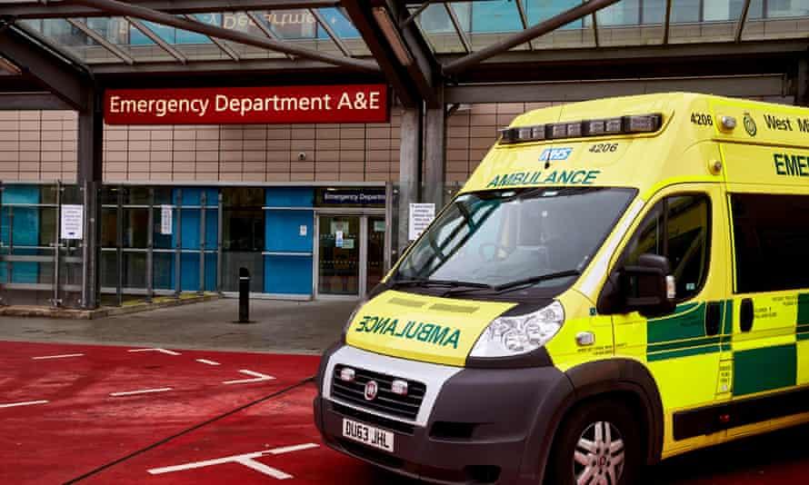 NHS ambulances wait outside a Birmingham hospital accident and emergency department