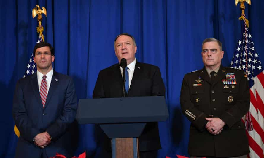 Former US secretary of defense Mark Esper (L) and chairman of the joint chiefs of staff US army general Mark Milley (R) standing beside US secretary of state Mike Pompeo (C) in 2019.