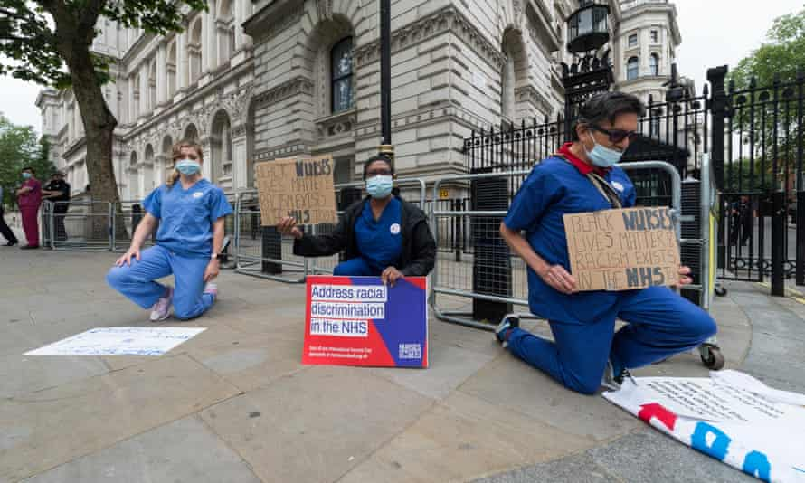 Nurses protest outside Downing Street, London in Jun 2020, highlighting a disproportionately high death rate among black and ethnic minority groups