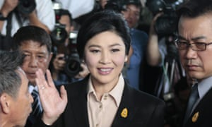 Yingluck Shinawatra greets well-wishers and supporters as she arrives at the supreme court on Tuesday.