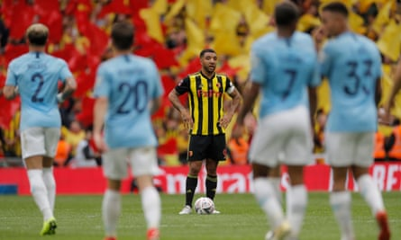 Watford captain Troy Deeney stands aghast after watching Manchester City score their sixth goal in the FA Cup final.