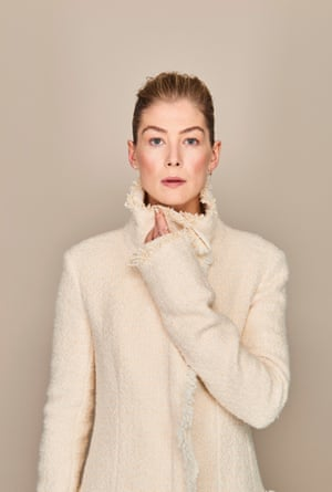 Rosamund wears coat, The Row, matchesfahsion.com. Left earring olelynggaard.com. Right earring ireneneuwirth.com. Rings doublemoss.com