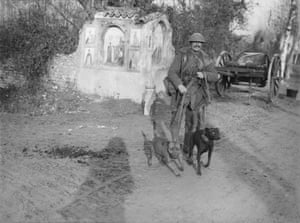 Ernest Brooks Soldier from the Royal Engineers with two messenger dogs and a roadside shrine December 1917