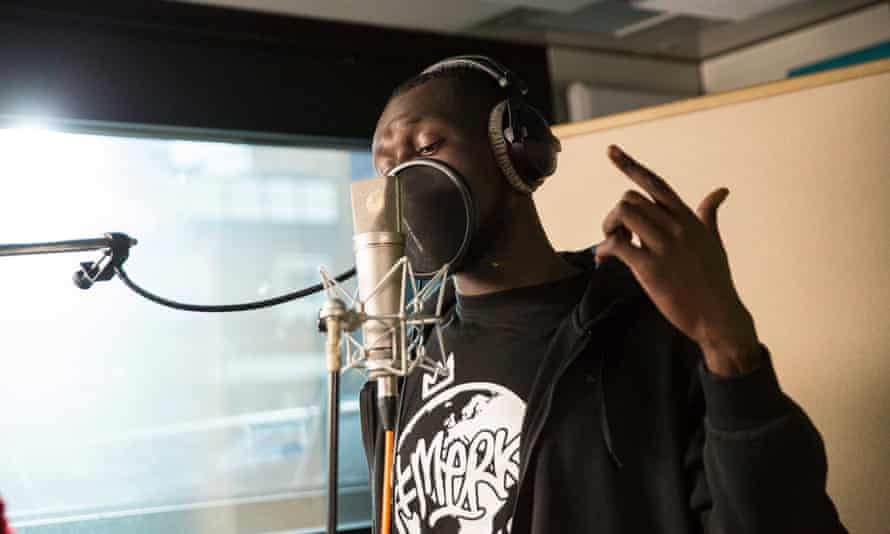 Grime star Stormzy records the opening verse of the Grenfell Tower charity single organised by Simon Cowell.