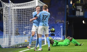 Phil Foden of Manchester City (left) celebrates scoring the second goal against Chelsea with Kevin De Bruyne.