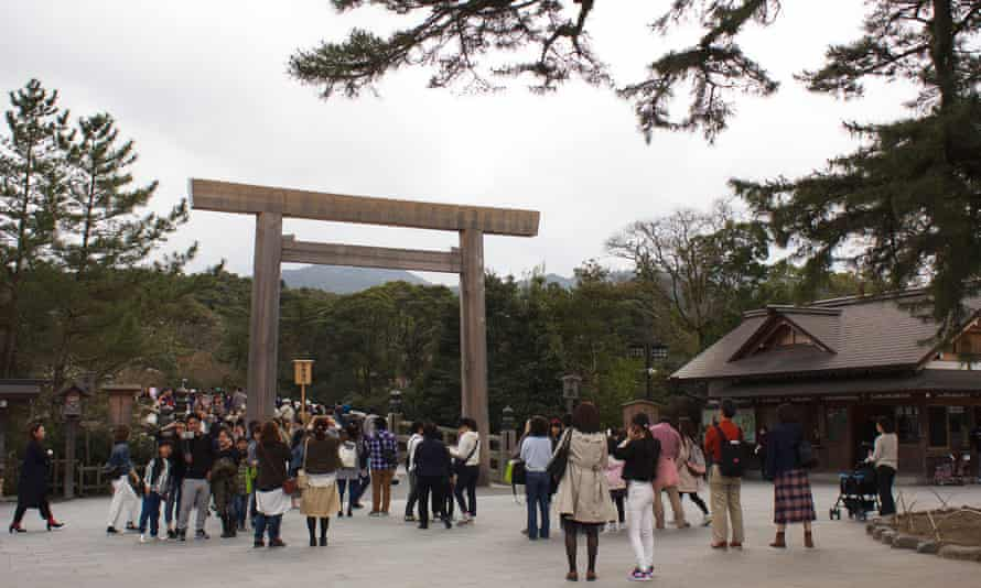 Visitors pass beneath the torii gate leading to the most sacred part of the Ise Jingu complex, Japan's most revered Shinto shrine.