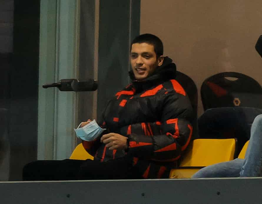 Raúl Jiménez watches from the stand.