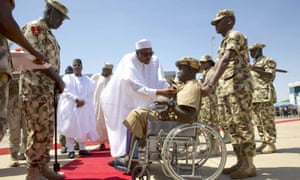 President Buhari presents Lance Corporal Kenneth Kulugh with the Purple Heart medal
