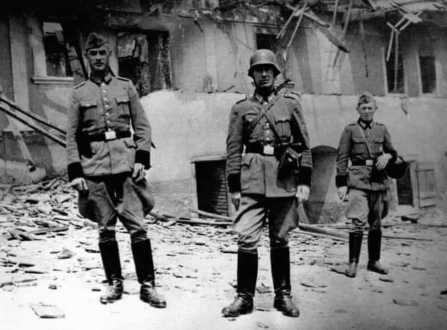 Schutzpolizei Nazi police pose among the ruins of Lidice.