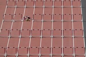 Trinidad and Tobago's Deborah John falls after crashing into a hurdle in heat five of the women's 100m hurdles.