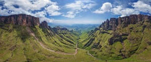Drakensberg, southern AfricaDrakensberg, which means Dragon's Mountain in Afrikaans, is the eastern part of a long, winding slope called the Great Escarpment. It's the edge of a high plateau of central southern Africa and in places the escarpment is 1,500 metres from base to top. The part shown in the photo is shaped like an amphitheatre: the pinnacles on the right are known as Dragon's Teeth.