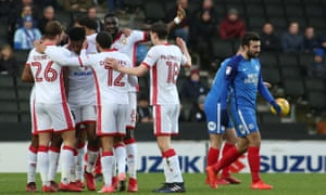MK Dons players – there were 10 at the time – celebrate Chuks Aneke's opening goal.