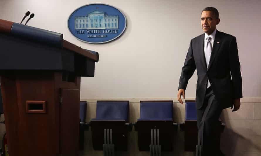 Barack Obama arrives in the White House's Brady press room to announce gun control reform efforts. The shooting at Sandy Hook elementary school was a defining moment of his presidency.