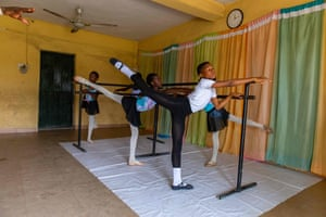 Students performing an arabesque at the barre. The academy, which Ajala funds out of his own pocket, has 12 pupils aged from six to 15