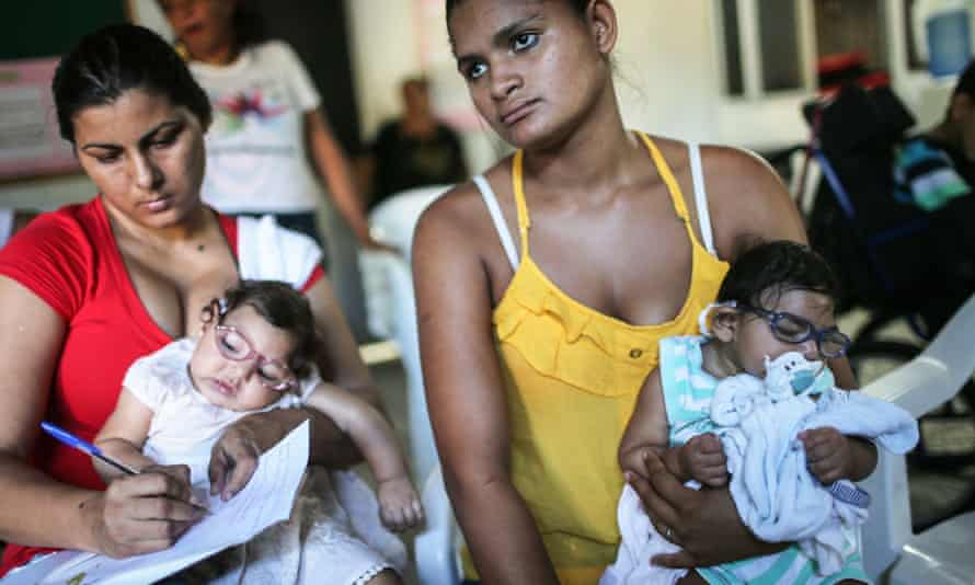 Infants born with microcephaly are held by mothers at a meeting for mothers of children with special needs on 2 June 2016 in Recife, Brazil.