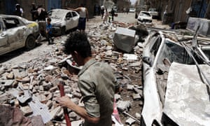 The aftermath of an airstrike carried out by warplanes of the Saudi-led coalition in Sana'a, Yemen