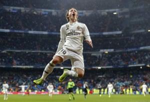Luka Modric celebrates sealing Real Madrid's La Liga victory over Sevilla.
